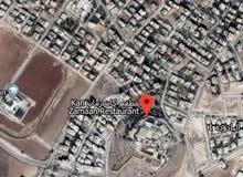 ارض للبيع مساحة 900 متر اليادوده قرب مطعم كان زمان حوض جدار البلد سكن ب