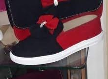 جنط وحذاء