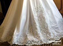 فستان زفاف لم يلبس بسعر مغري