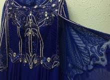 فستان مناسبات مطرز بالفصوص الفخمة