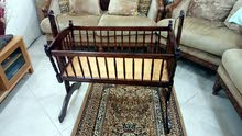 swinging wooden cot for baby