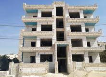 شقة شبه ارضية مع حديقة اقساط في عرجان((مقابل هيئة الاوراق المالية)) ومن المالك مباشرة