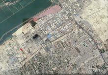ارض ناصية 415 م مكان مميز ببرج العرب للبيع