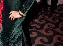 فستان زيتي قطيفه لبسه واحده