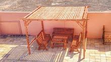 تفصيل جلسات خشبية لحديقة المنزل مظلات كراسي طاولات