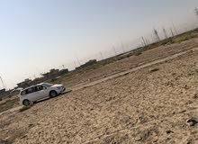 قطع اراضي للبيع في البصرة في منطقه الهارثه الشارع المقابل سيد سامي