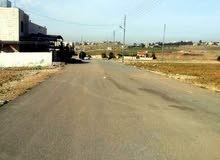 قطعـة أرض استثمارية وذات إطلالة للبيـع على طريق المطار منطقة اللبن حوض مارس زيدان