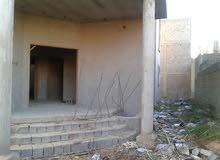 فيلا خلف مصرف (التنميه) القريب من بنغازي الجديده