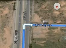 ارض واجهتين في طريق المطار وسوم كزيوني