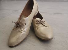 Flat gold leather shoes, excellent  condition.