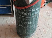 سلندر شركة غاز البحرين مع المنظم والهوز  معبئ نصف غاز تقريبا