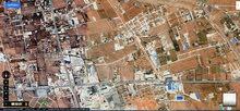 قطع اراضي لبيع الهواري شارع الكتربيل قبل جزيرة اسمنتـ
