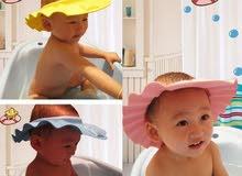 قبعة أطفال زرقاء لغسيل شعر الطفل بالشامبو