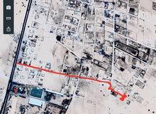 قطعة ارض في شارع الهرم او شارع الاستطلاع  تبعد عن الطريق حوالي 600 متر
