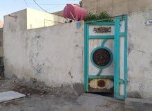 بيت على شارع بغداد مباشرتا للايجار
