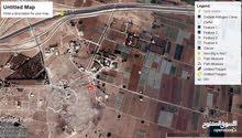 ارض 870م للبيع طريق المطار بجانب جامعة الاسراء