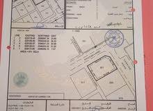 ارض صناعيه كونر 2 جهات مسفاه 6 على شارع وسط محلات مع اساس قايم