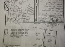 ارض تجاريه سكنيه للبيع في جعلان بني بوعلي خلف بنك ظفار