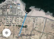 قطعة ارض 400م مسيجة وبها بئر في صبراته منطقة الصبيخة قريبة من البحر