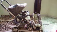 عربة اطفال مع الكرسي GRACO