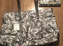 حقيبة يد piaza italia + حقيبة اوراق مجانا