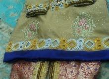 ملابس تقليدية وفساتين سهرة