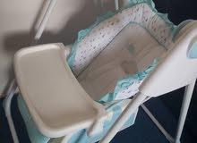 مرجيحة اطفال بسرير هزاز من ماركة جونيورز