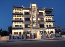 شقة مع روف فاخرة جدا ومميزة للبيع طريق المطار ضاحية الامير علي مقابل عمان ويفز