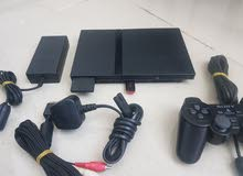 PS2 Slim with one controller + 21 games installed