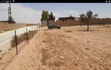 قطعه أرض بعد خزانات الطلحيه وبلقرب من مصنع نافوسه للدقيق