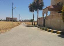 قطعة أرض للبيع في منطقة الطنيب مقابل جامعة الإسراء مباشرة طريق المطار
