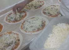 بيتزا ومقلوبا