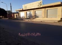 مبني وارض تجارية للبيع منطقة القوشي/مصراته