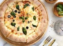 شيف بيتزا ومعجنات اضافه إلى طبخ الطلياني