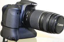 كاميرا كانونeos 200d مع عدسة 75/300 مع ترايبوت مستعمله اربعة اشهر للبيع بداعي ال