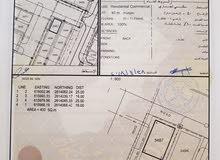 أرض سكني تجاري المعبيله 2/5 كورنر على شارعين قار ومواقف واسعه موقع حيوي جدا