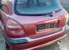 Nissan Almera 2004 For sale - Maroon color