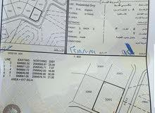 أرض في العامرات النهضه بداية الإمتداد الأول قريب 2/11 ملاصقه بيت