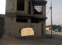 بيت مساحته 100م في البلديات منطقة المعسكر