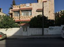 ارض تجاريه مقام عليها منزل من شقتين طابقيات,شارع الشهداء