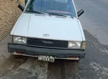 سيارة تويوتا كورولا 1983 لون ابيض خالي قص قلبان والسعر قابل للتفاوض