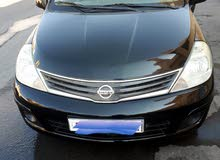 Nissian Tiida 1.8 black color with any accident history