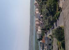 ارض  عقارية سياحية سكنية بمنطقة راقية اطلالة مباشرة على بحيرة مساحة 310 م