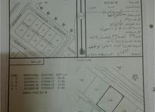 أرض للبيع في إزكي قلعة العوامر مقابل مركز صحي مربع 1 رقم القطعة 130