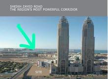 للبيع ارض زاوية استخدم تجاري سكني بشارع الشيخ زايد التيكوم