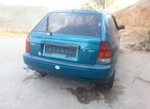 Green Mazda 323 1998 for sale