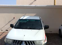 Manual White Mitsubishi 2010 for rent