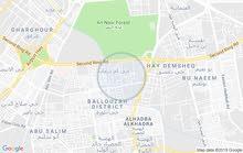 قطعة ارض فضاء مسيجة خلف مستشفى الخضراء بشارع شركة الضمان والتسسير الفندقي