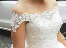 فستان عروسة ابيض ملكي