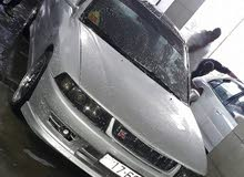 For a Day rental period, reserve a Mitsubishi Lancer 1999